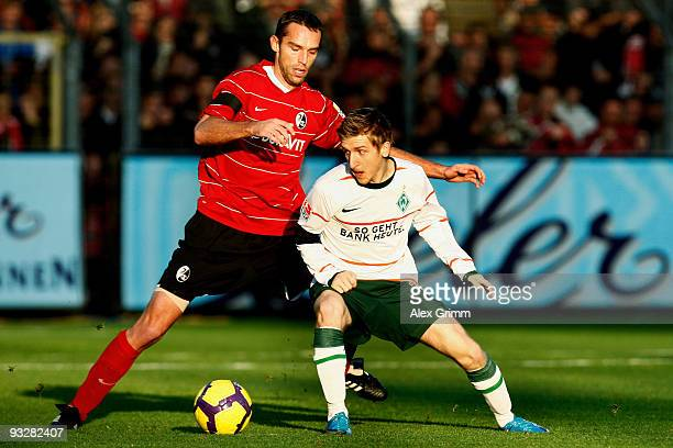 Marko Marin of Bremen is challenged by Pavel Krmas of Freiburg during the Bundesliga match between SC Freiburg and Werder Bremen at the Badenova...