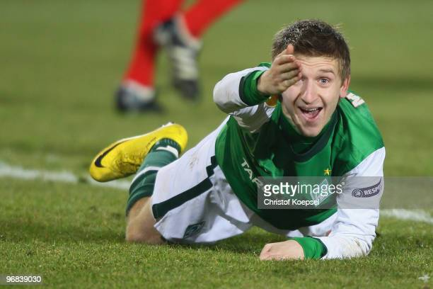 Marko Marin of Bremen lies on the pitch and shouts during the UEFA Europa League knockout round first leg match between FC Twente Enschede and SV...