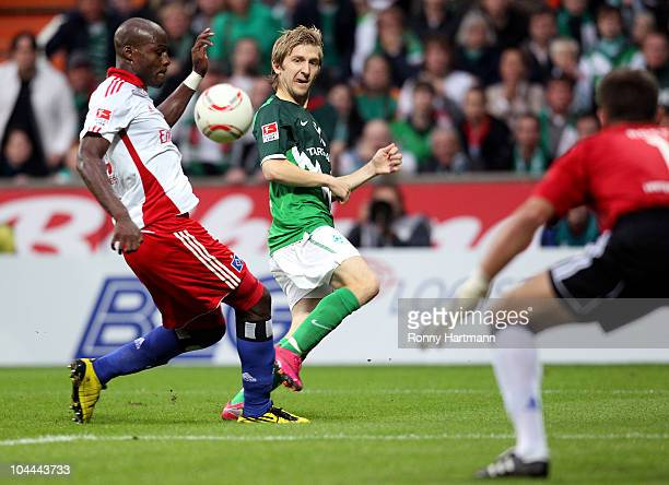 Marko Marin of Bremen scores his teams first goal against Guy Demel and Goalkeeper Frank Rost of Hamburg during the Bundesliga match between SV...