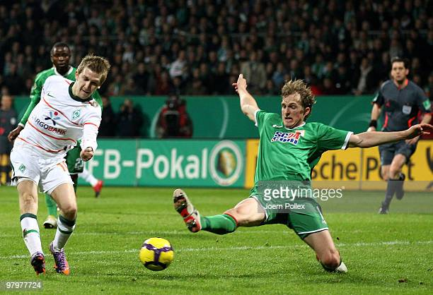 Marko Marin of Bremen scores his team's first goal during the DFB Cup Semi Final match between SV Werder Bremen and FC Augsburg at Weser Stadium on...