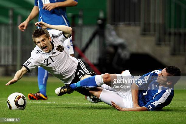 Marko Marin of Germany is tackled for a penalty by Sanel Jahic of BosniaHerzegovina during the international friendly match between Germany and...
