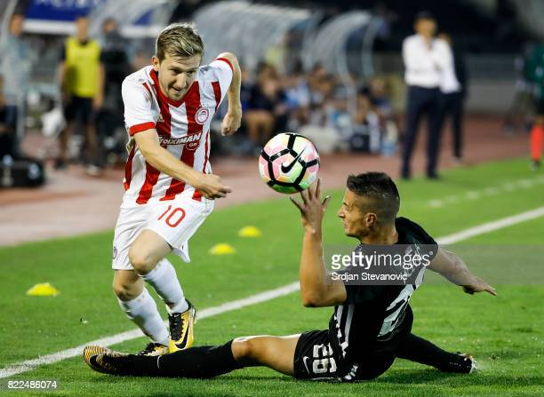 Marko Marin of Olympiacos in action against Nemanja Miletic of Partizan during the UEFA Champions League Qualifying match between FC Partizan and...