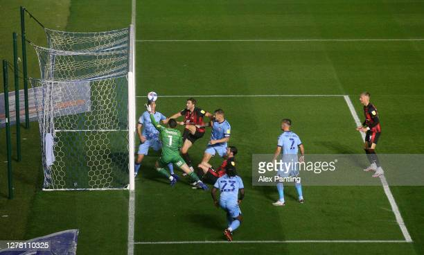 Marko Marosi of Coventry City makes a save from Dan Gosling of AFC Bournemouth during the Sky Bet Championship match between Coventry City and AFC...