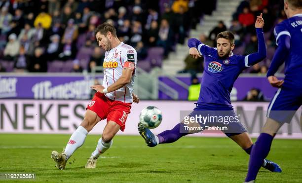 Marko Mihojevic of Aue is challenged by Marco Gruettner of Regensburg during the Second Bundesliga match between FC Erzgebirge Aue and SSV Jahn...