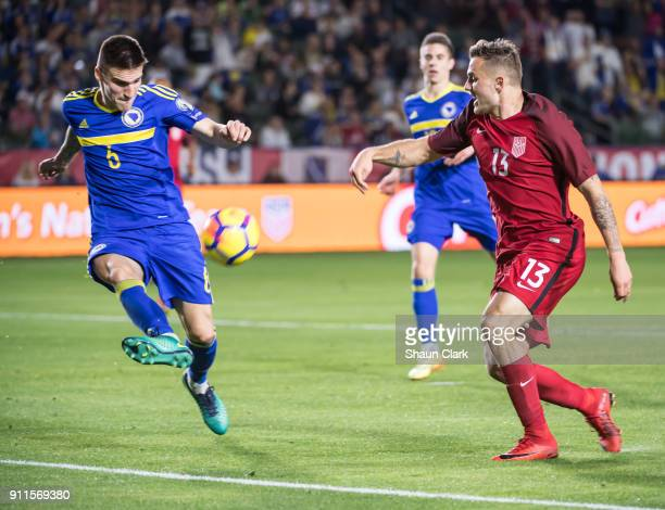 Marko Mihojevic of Bosnia Herzegovina clears the ball before Jordan Morris of the United States can get a shot off during the international friendly...