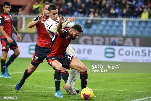 Marko Pajac and Davide Biraschi of Genoa CFC battle for the ball with Alejandro Berenguer of Torino FC during the Serie A match between Genoa CFC and...