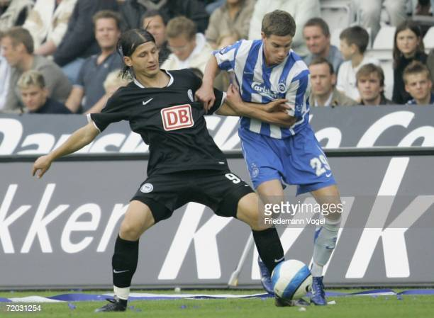 Marko Pantelic of Hertha tussles for the ball with Jonas Borring of Odense during the UEFA Cup second leg match between Odense BK and Hertha BSC...