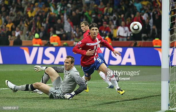 Marko Pantelic of Serbia scores his side's first goal past Mark Schwarzer of Australia during the 2010 FIFA World Cup South Africa Group D match...