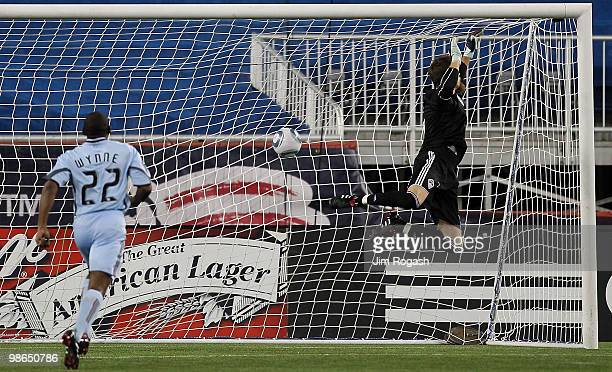 Marko Perovic of the New England Revolution scores a goal against goalie Matt Pickens and defender Marvell Wynne of the Colorado Rapids at Gillette...