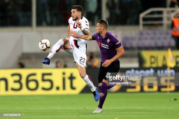 Marko Pjaca of ACF Fiorentina battles for the ball with Luca Ceppitelli of Cagliari during the Serie A match between ACF Fiorentina and Cagliari at...