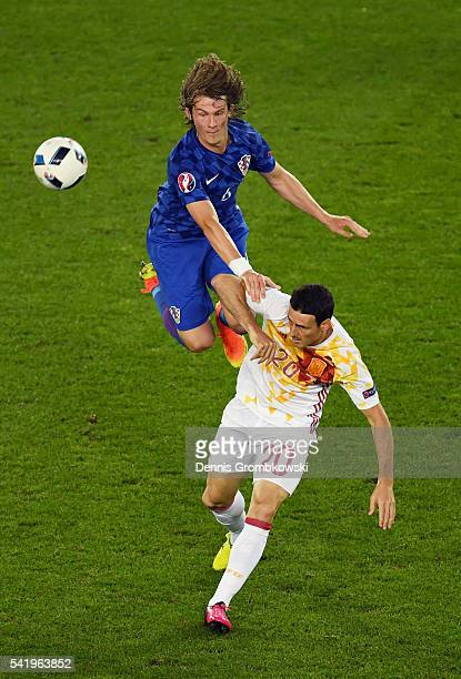 Marko Pjaca of Croatia and Aritz Aduriz of Spain compete for the ball during the UEFA EURO 2016 Group D match between Croatia and Spain at Stade...
