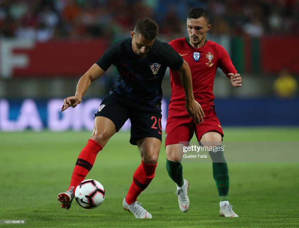 Marko Pjaca of Croatia and Fiorentina with Mario Rui of Portugal and Napoli in action during the International Friendly match between Portugal and Croatia at Estadio Algarve on September 6, 2018 in Faro, Portugal.