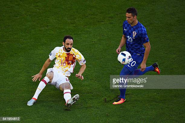 Marko Pjaca of Croatia and Juanfran of Spain compete for the ball during the UEFA EURO 2016 Group D match between Croatia and Spain at Stade Matmut...