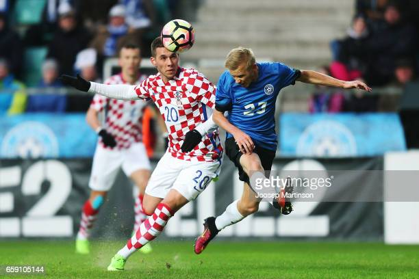 Marko Pjaca of Croatia competes with Taijo Teniste of Estonia during international friendly between Estonia and Croatia at A le Coq Arena on March 28...