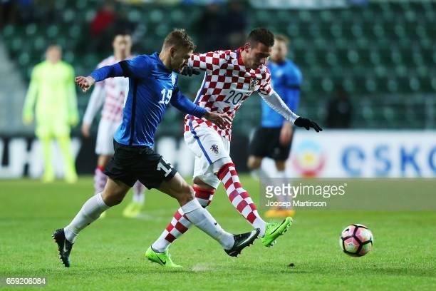 Marko Pjaca of Croatia passes the ball against Ken Kallaste of Estonia during international friendly between Estonia and Croatia at A le Coq Arena on...