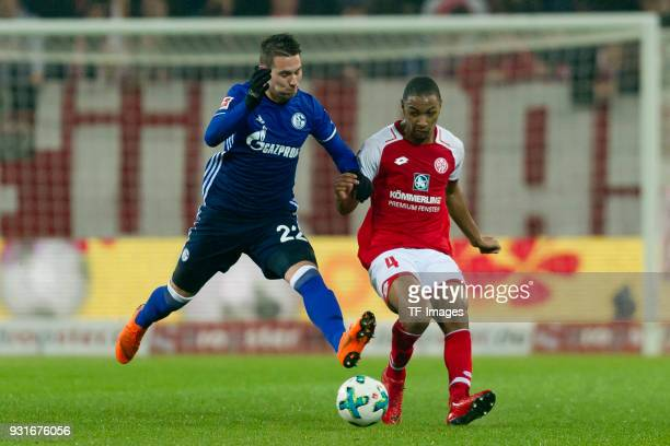 Marko Pjaca of Schalke and Abdou Diallo of Mainz battle for the ball during the Bundesliga match between 1 FSV Mainz 05 and FC Schalke 04 at Opel...