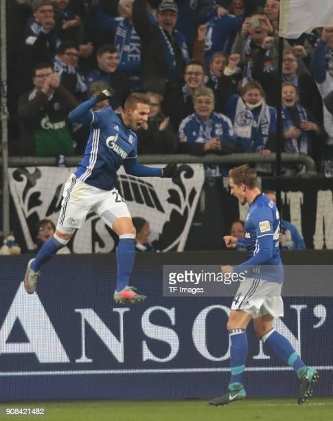 Marko Pjaca of Schalke celebrates after scoring his team`s first goal with Bastian Oczipka of Schalke during the Bundesliga match between FC Schalke...