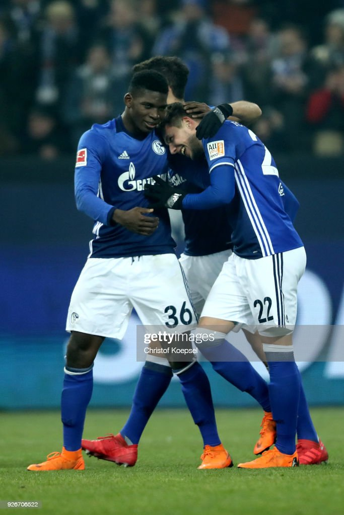 Marko Pjaca of Schalke (R) celebrates the first goal with Breel Embolo (L) and Franco Di Santo (C) of Schalke during the Bundesliga match between FC Schalke 04 and Hertha BSC at Veltins-Arena on March 3, 2018 in Gelsenkirchen, Germany.