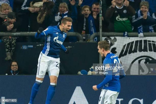 Marko Pjaca of Schalke celebrates with Bastian Oczipka of Schalke after scoring his team`s first goal during the Bundesliga match between FC Schalke...