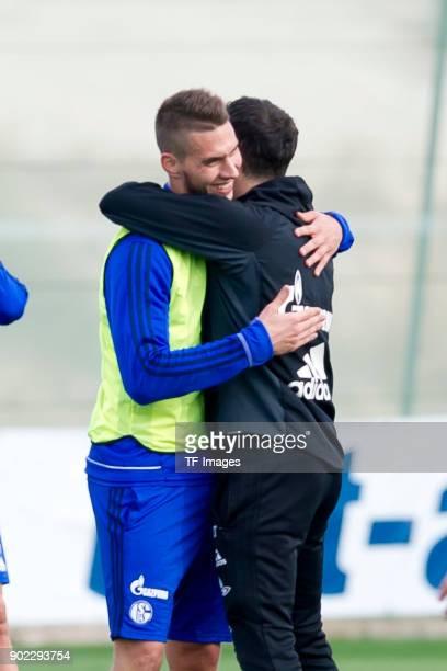 Marko Pjaca of Schalke hugs Head coach Domenico Tedesco of Schalke during the FC Schalke 04 training camp at Hotel Melia Villaitana on January 06...