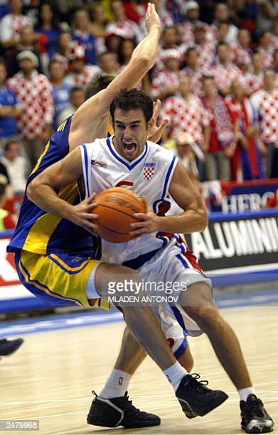 Marko Popovic from Croatia is fouled as he drives to the basket against Alexander Lokhmanchuk from Ukraine during their match in group D of the FIBA...