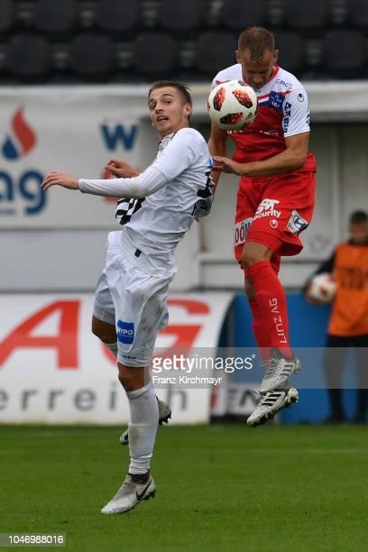 Marko Raguz of Juniors OOe and Martin Kreuzriegler of FC Linz during the 2 Liga match between FC Juniors OOe v FC Blau Weiss Linz at TGW Arena on...