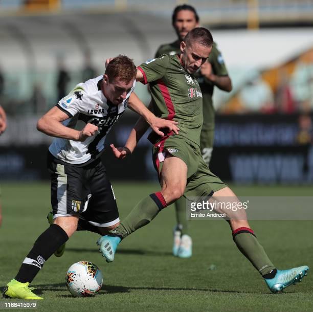 Marko Rog of Cagliari Calcio competes for the ball with Dejan Kulusevski of Parma Calcio during the Serie A match between Parma Calcio and Cagliari...