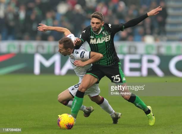 Marko Rog of Cagliari Calcio is challenged by Domenico Berardi of US Sassuolo during the Serie A match between US Sassuolo and Cagliari Calcio at...