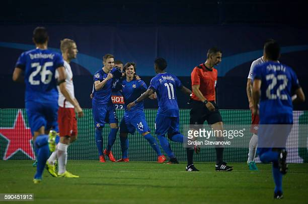 Marko Rog of Dinamo Zagreb celebrate scoring the goal with the team mates Ante Coric and Junior Fernandes during the UEFA Champions League Playoffs...