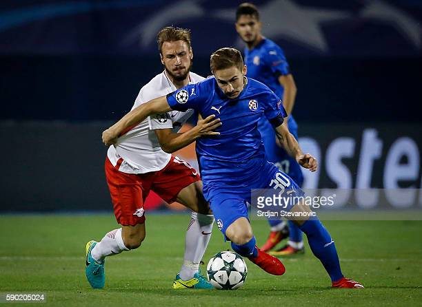 Marko Rog of Dinamo Zagreb in action against Andreas Ulmer of Salzburg the UEFA Champions League Playoffs First leg match between Dinamo Zagreb and...