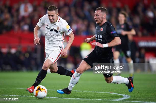 Marko Rog of Sevilla FC competes for the ball with Vladimir Coufal of Slavia Prague during the UEFA Europa League Round of 16 First Leg match between...