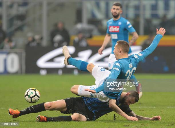 Marko Rog of SSC Napoli competes for the ball with Marcelo Brozovic of FC Internazionale Milano during the serie A match between FC Internazionale...