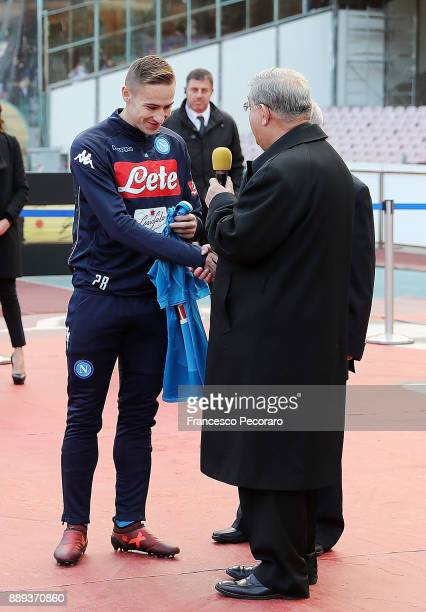 Marko Rog of SSC Napoli gives an SSC Napoli football shirt to the cardinal Crescenzio Sepe with his name on the back before the Serie A match between...