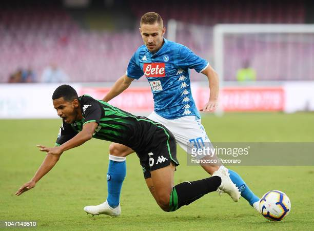Marko Rog of SSC Napoli vies Rogerio of US Sassuolo during the Serie A match between SSC Napoli and US Sassuolo at Stadio San Paolo on October 7 2018...