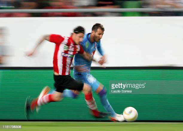 Marko Scepovic of MOL Vidi FC competes for the ball with Bence Batik of Budapest Honved during the Hungarian Cup Final match between Budapest Honved...