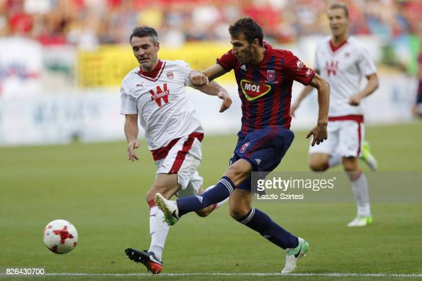 Marko Scepovic of Videoton FC and Jeremy Toulalan of FC Girondins de Bordeaux in action during the UEFA Europa League Third Qualifying Round Second...