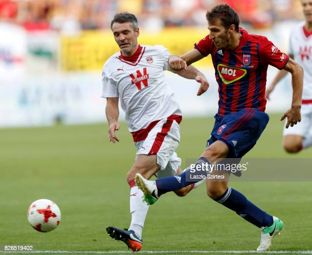 Marko Scepovic of Videoton FC shoots on goal next to Jeremy Toulalan of FC Girondins de Bordeaux during the UEFA Europa League Third Qualifying Round...