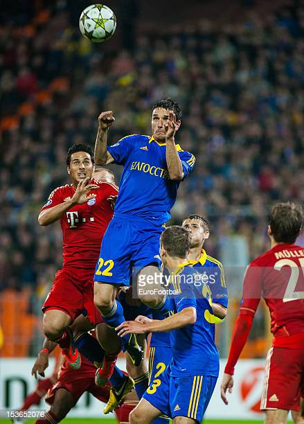 Marko Simic of FC BATE Borisov rises above Claudio Pizarro of FC Bayern Muenchen to clear the ball from danger during the UEFA Champions League group...