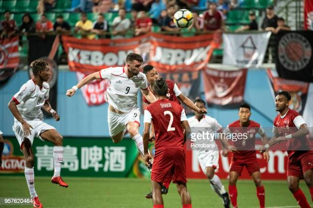 Marko Simic of Persija Jakarta is challenged by Fazli Ayob of Home United during the AFC Cup Zonal Semi final between Home United and Persija Jakarta...