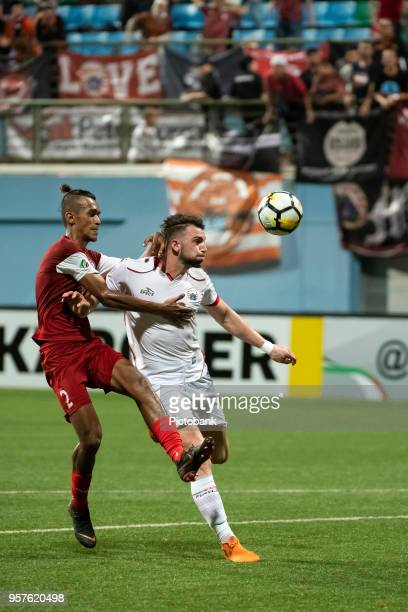 Marko Simic of Persija Jakarta is challenged by Shakir Hamzah of Home United during the AFC Cup Zonal Semi final between Home United and Persija...
