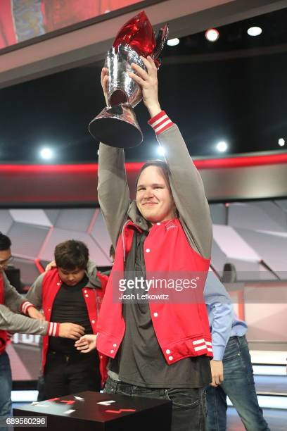 Marko Sosnicki holds the championship trophy at the League of Legends College Championship between Maryville University and the University of Toronto...
