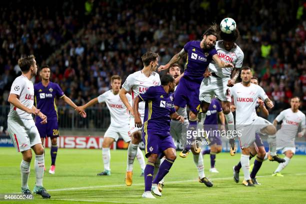 Marko Suler of NK Maribor challenges Luis Adriano of Spartak Moskva during the UEFA Champions League Group E match between NK Maribor and Spartak...