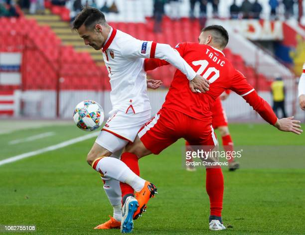 Marko Vesovic of Montenegro in action against Dusan Tadic of Serbia during the UEFA Nations League C group four match between Serbia and Montenegro...