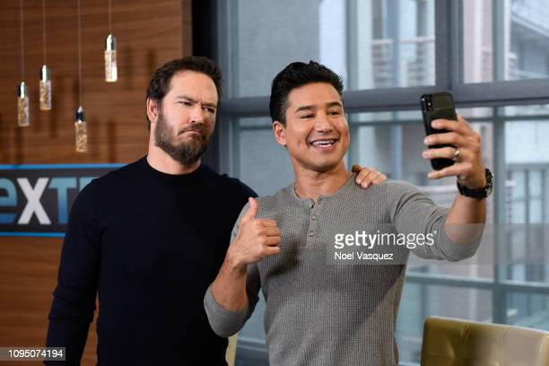 MarkPaul Gosselaar and Mario Lopez take a selfie together at Extra at Universal Studios Hollywood on January 16 2019 in Universal City California