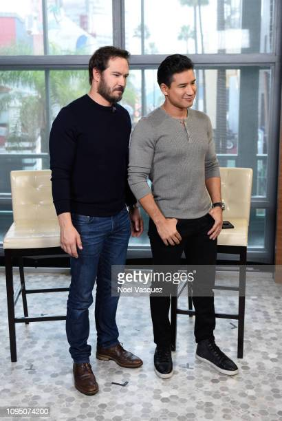 MarkPaul Gosselaar and Mario Lopez visit Extra at Universal Studios Hollywood on January 16 2019 in Universal City California