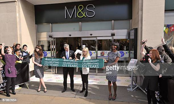 Marks and Spencer chairman Sir Stuart Rose and model Twiggy cut the opening ribbon outside Marks and Spencer's flagship store on Oxford Street in...