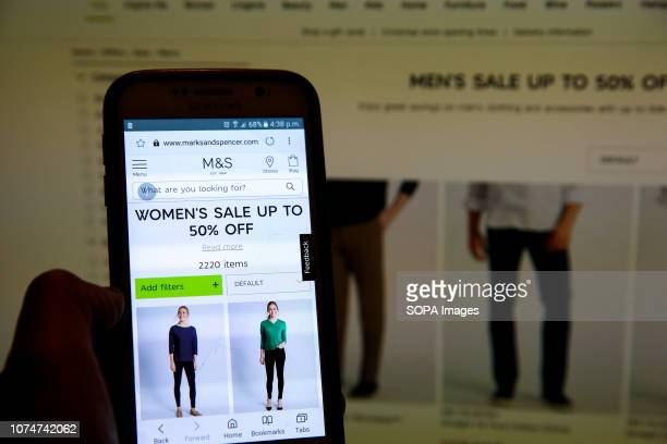 Marks Spencer Boxing Day online sale is seen on a computer and mobile phone Boxing Day online sales has begun in many high street stores as shops try...