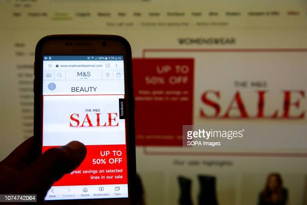 Marks Spencer Boxing Day online sale is seen on a mobile phone Boxing Day online sales has begun in many high street stores as shops try to make up...