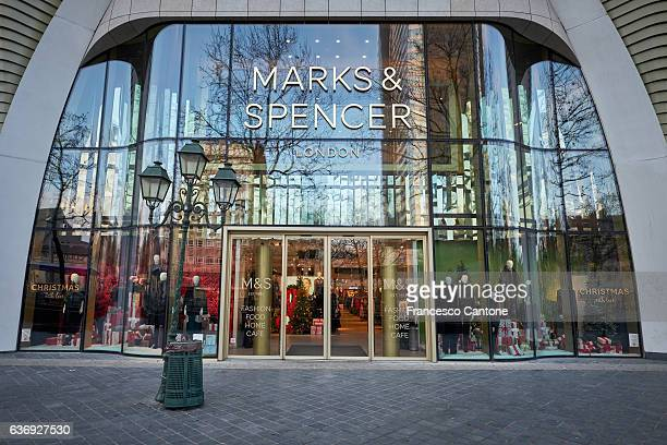 marks & spencer sign - store in brussels - high up stock photos and pictures