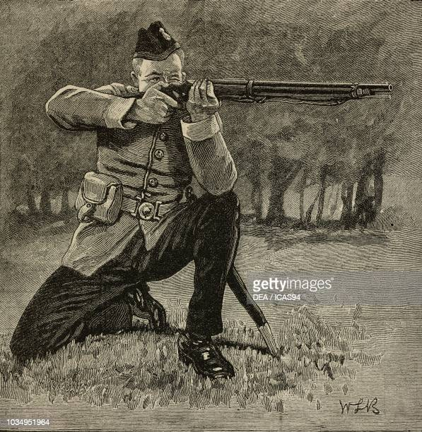 A marksman in kneeling position for present arms command school of musketry in Hythe United Kingdom engraving from The Illustrated London News vol 89...